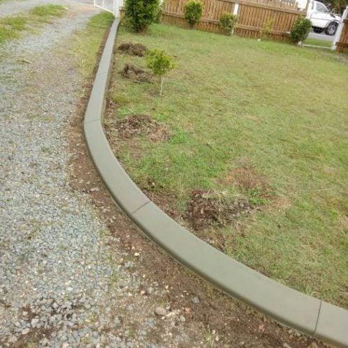 Continuous concrete driveway edging kerb on suburban block