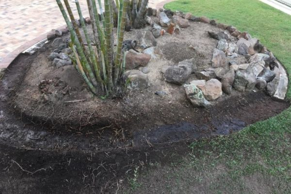 Continuous concrete garden edging kerb before being repaired